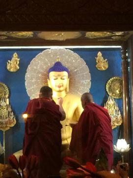 H.E. Jamgon Kongtrul Rinpoche (l) and Karma Wangchuk (r) painting the Buddha in the main Stupa in Bodhgaya.